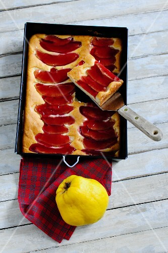 Quince cake in a baking tin