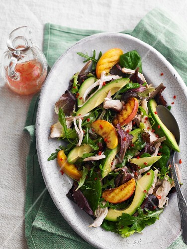 Chicken salad with avocado and grilled peach wedges