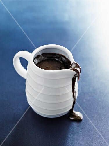Chocolate sauce in a white jug