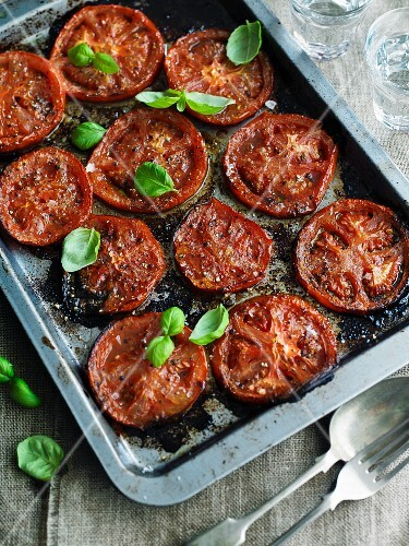 Oven-baked tomatoes with basil
