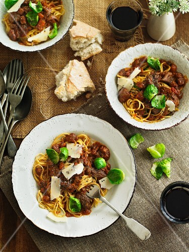 Spaghetti with venison ragout and Parmesan cheese
