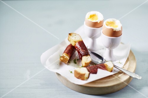 Soft boiled eggs and bacon-wrapped soldiers for breakfast