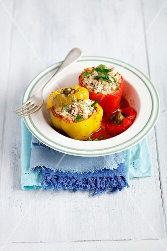 Peppers filled with rice and minced meat in tomato sauce