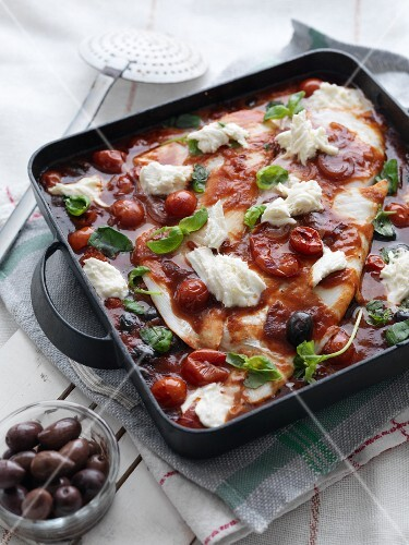 Plaice with tomatoes, mozzarella, basil and olives