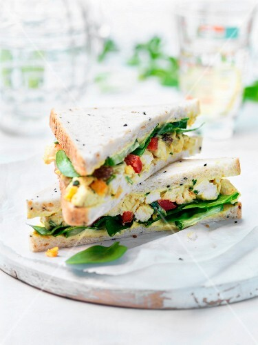 Classic coronation chicken salad sandwich with spinach