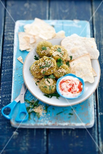 Herb falafel with a yoghurt sauce and unleavened bread