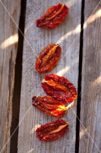 Dried tomatoes on a wooden surface