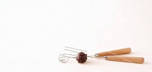 Praline forks and a truffle praline