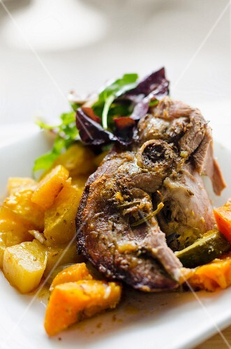 Lamb on a bed of vegetables