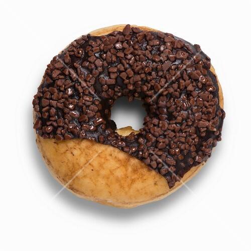 A Nutella doughnut with chocolate glaze and chocolate sprinkles