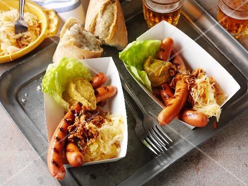 Hotdogs with sauerkraut and mustard to take away