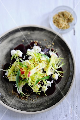 Beetroot salad with apples and frisee lettuce