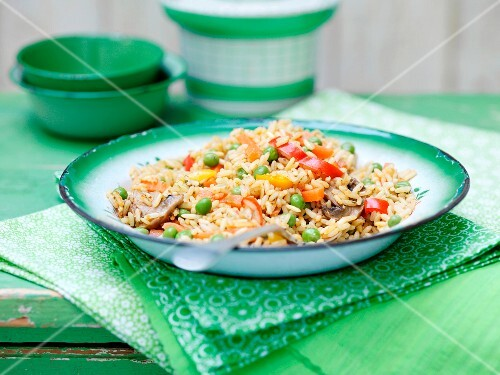 Vegetable rice in a green enamel bowl