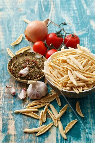 Capunti and ingredients for puttanesca sauce