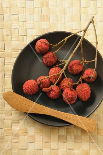 Lychees on a sprig on a plate