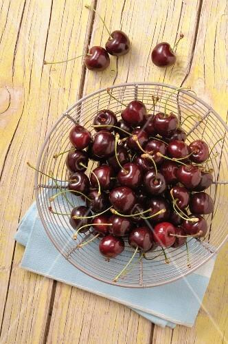 Fresh cherries in a wire basket