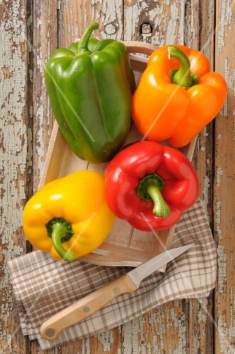 Colourful peppers on a wooden tray