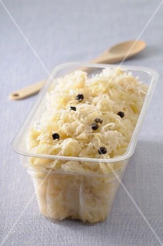 Sauerkraut in a plastic container