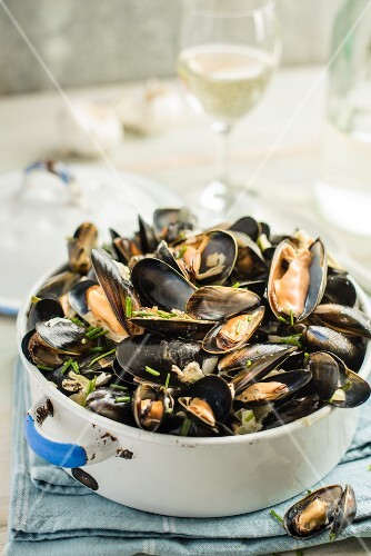 Mussels in a white wine broth with garlic and herbs