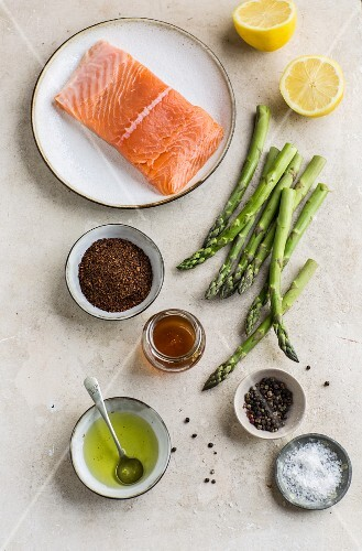 Raw salmon fillet with various ingredients (seen from above)