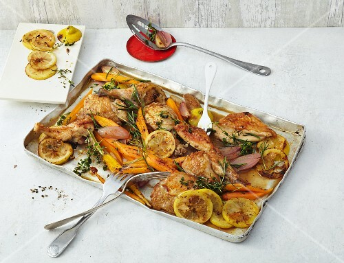 Oven-baked lemon chicken with carrots and shallots