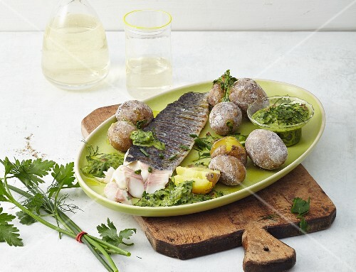 Grilled trout fillets with potatoes and a green sauce