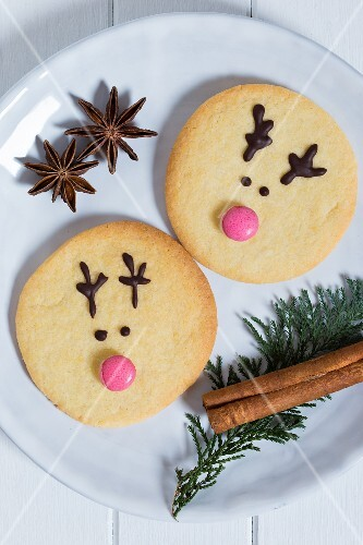 Reindeer biscuits decorated with pink chocolate beans for Christmas