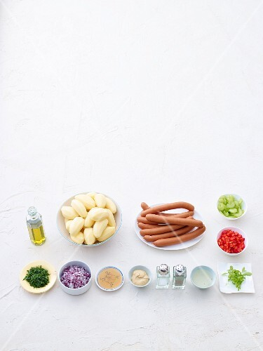 Ingredients or potato salad with sausages