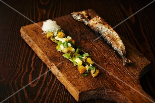 Trout grilled over a wood fire with Caesar salad