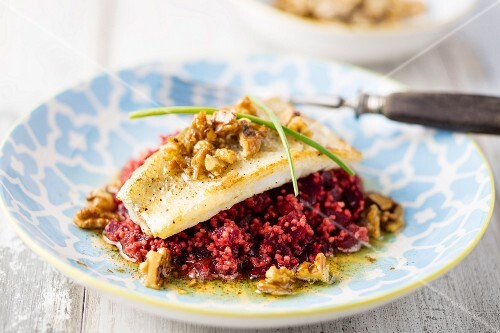 Zander on a bed of beetroot couscous