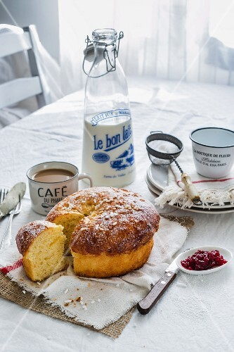 A French breakfast with café au lait, brioche, jam and a bottle of milk