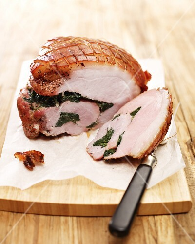 Roast ham stuffed with spinach, sliced