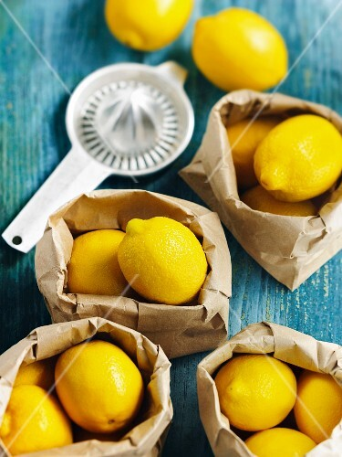 Lemons in brown paper bags