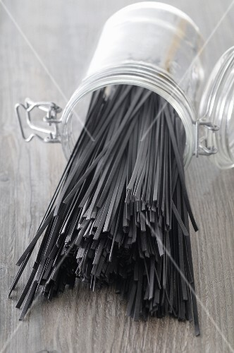 Squid spaghetti in an overturned jar