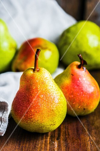 Fresh pears on a wooden surface