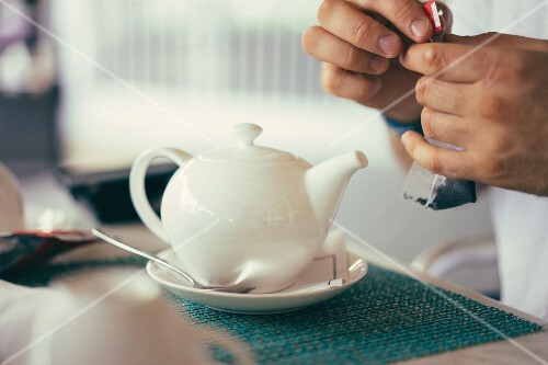 A white teapot in a restaurant