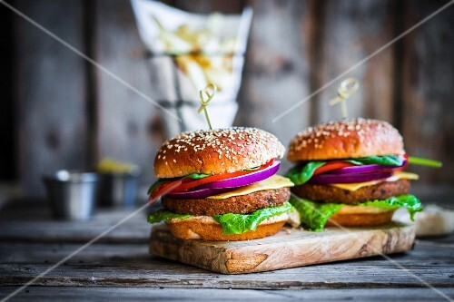 Homemade burgers on rustic wooden surface