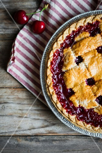 Homemade cherry pie on a rustic surface