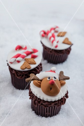 Chocolate cupcakes decorated with reindeer and candy canes for Christmas