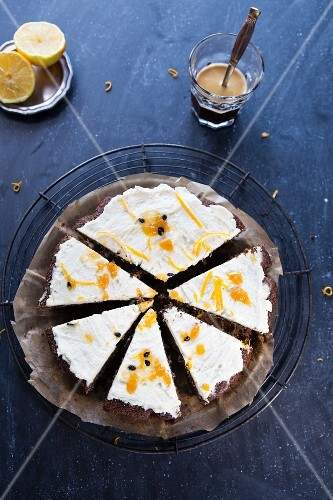 Poppyseed cake with lemon and cream cheese frosting, sliced
