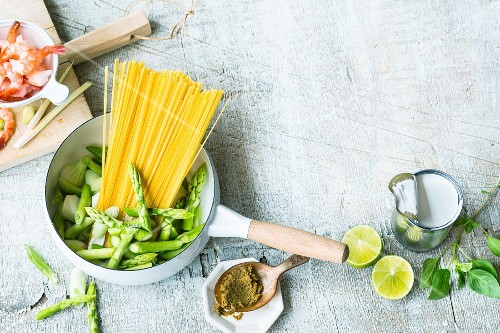 An arrangement of ingredients for an oriental one pot noodle dish