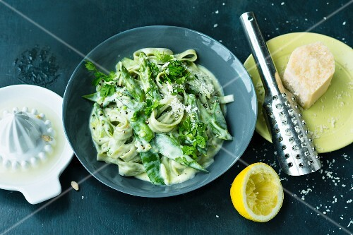 Green vegetable pasta with lemon sauce and Parmesan cheese