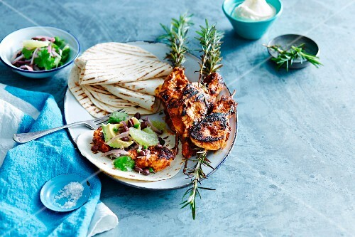 Tortilla wraps with grilled chilli chicken and a bean salsa