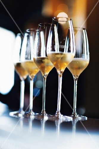 Glasses of champagne in the Le Clos des Terres Soudées winebar, Champagne, France