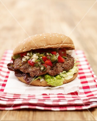 Grilled burger with chilli salsa