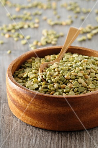 Dried peas in a wooden bowl
