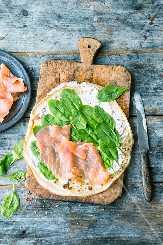 A crepe topped with salmon and spinach