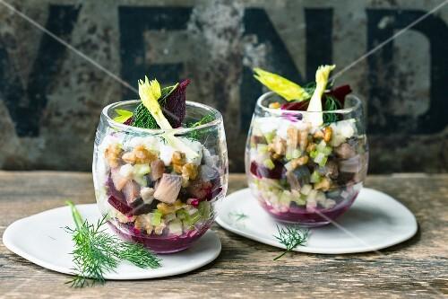 Mini soused herring layered salad