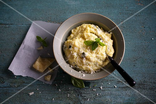 Polenta with basil and grated Parmesan cheese