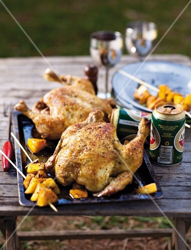 Beer-can chicken with pineapple skewers